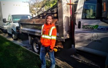 Grounds Maintenance - Girl beside Greenscape truck